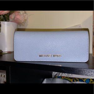 MICHAEL KORS light blue wallet.